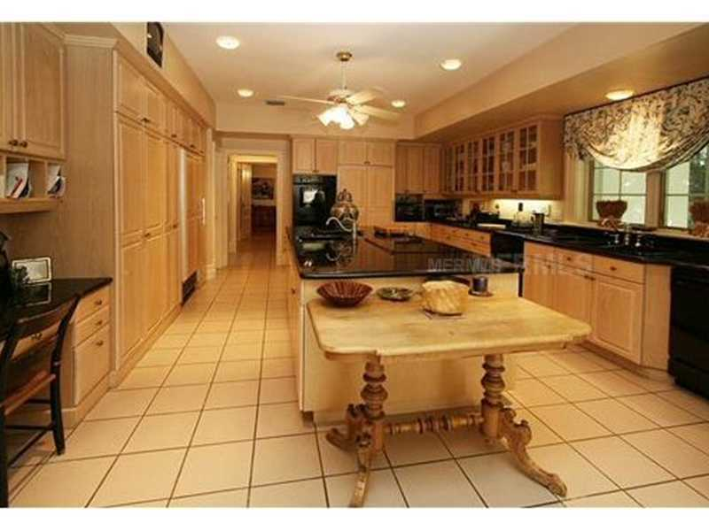 Extremely spacious cabinetry and custom designed cooking island.