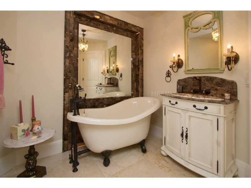 Quaint bathroom with European features.