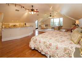 The home has a bedroom suite over the four-car garage featuring a complete kitchen.