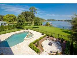This home offers panoramic views of Lake Burkett. Plus, a large pool and Jacuzzi.