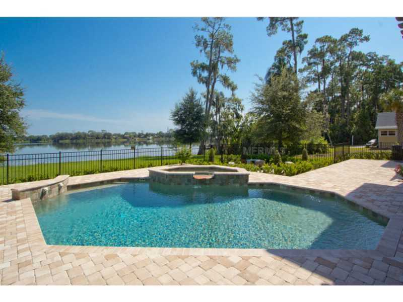 This home offers a heated pool, spa and a boat dock.