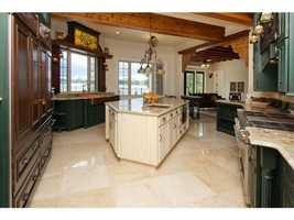 The kitchen space is 20 feet by 17 feet. It is complete with modern appliances and an eating space.