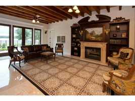 This family room is adjacent to the kitchen and also overlooks the lake.