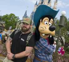 Country music artist Zac Brown, singer/songwriter for the Grammy Award-winning Zac Brown Band, poses March 18, 2013 with Goofy at the Magic Kingdom park.