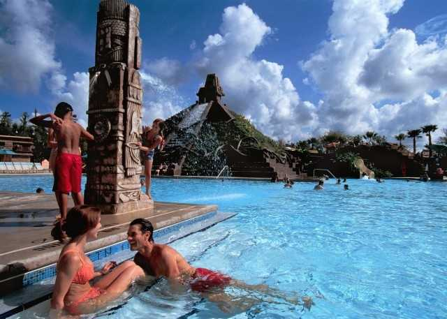 A five-story Mayan pyramid serves as the splashy centerpiece for the family-fun pool at Disney's Coronado Springs Resort.
