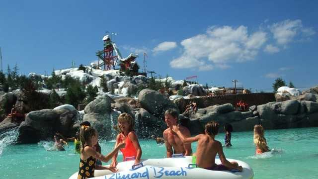 Melt-Away-Bay wave pool at Disney's Blizzard Beach water theme park offers a relaxing chance to chill out for the whole family. Mt. Gushmore, the 12-story-tall park icon, and the Summit Plummet thrill slide can be seen in the background.
