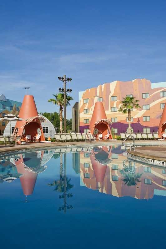 "At Disney's Art of Animation Resort, the Cozy Cone Motel anchors the ""Cars"" courtyard with its orange cone-shaped cabanas inviting guests to kick back and relax at the pool near Lightning McQueen, Fillmore, Sarge and other characters from the popular film."