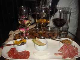 A perfect meal for Aixa would include wine, cheese, and cured meats!