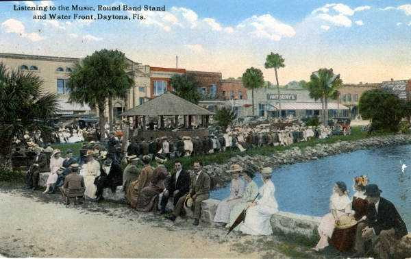 A postcard from 1910 shows people sitting waterfront in Daytona Beach.