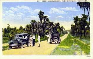 A 1925 postcard shows friends meeting along the Dixie Highway in Florida.