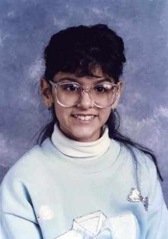 "In 5th grade, a bespectacled Aixa anchored the school announcements (before ""geek"" was ""chic"" thank you very much!)"