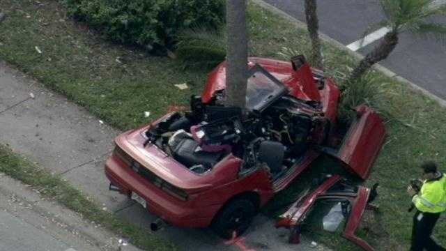 Two people were flown to a hospital Friday morning when a car was split after crashing into a tree in Kissimmee.