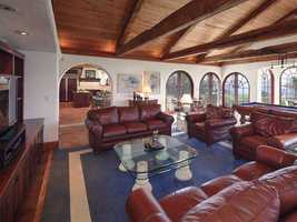 Enjoy casual nights in the family room with game room area and additional eating space overlooking Lake Tibet.