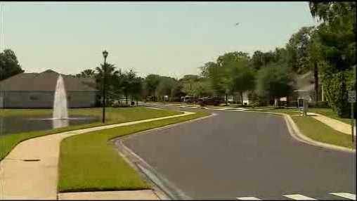 A woman getting into her car at her Sanford apartment complex said she approached by three teens who threatened her with a gun Thursday, police said.