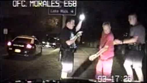 Police video in Eustis shows a drunken driving suspect nearly running into dozens of cars.
