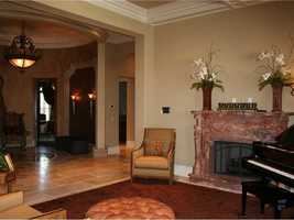 Relax in the formal sitting area next to the fireplace.