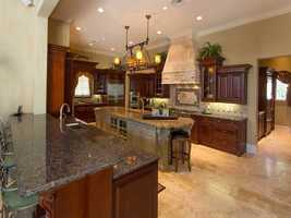 The kitchen is features all of a cook's most coveted amenities.