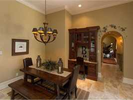 The quaint dining nook has the old-world charm seen throughout the house.
