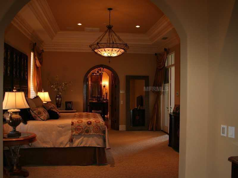 The first floor master suite includes a sitting area and coffee bar.