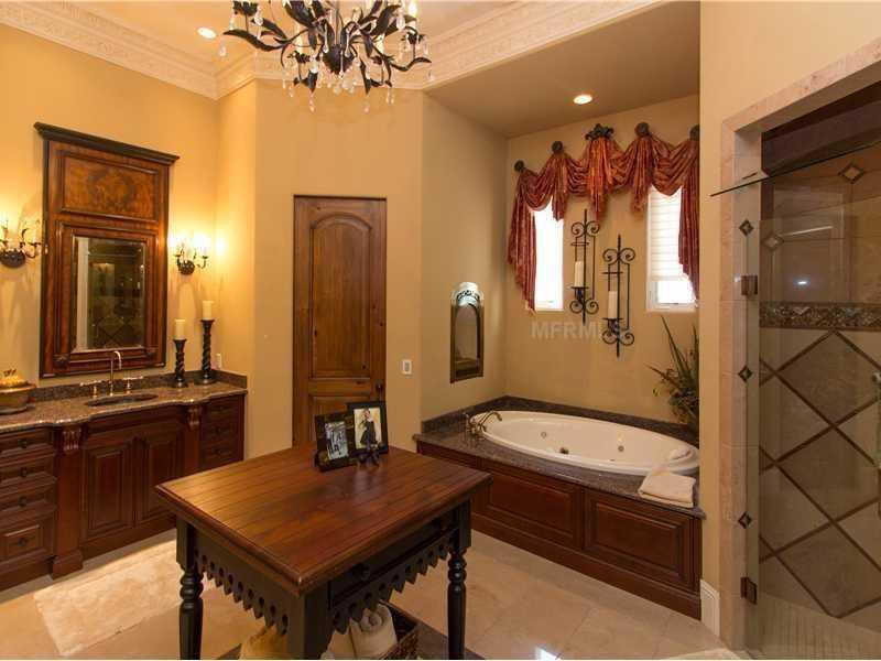 The master bathroom features a Fireside Roman tub.