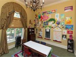 This bedroom was transformed into a children's play room, a fun and creative space.