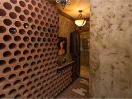 The wine cellar has room for hundreds of bottles.