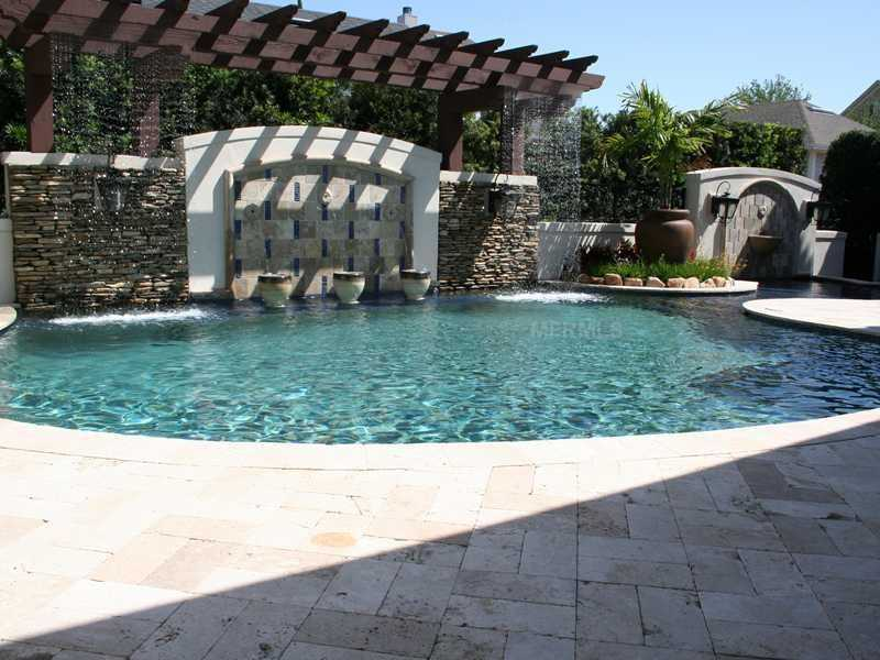 Beautiful fountains and waterfalls flow along the pool.