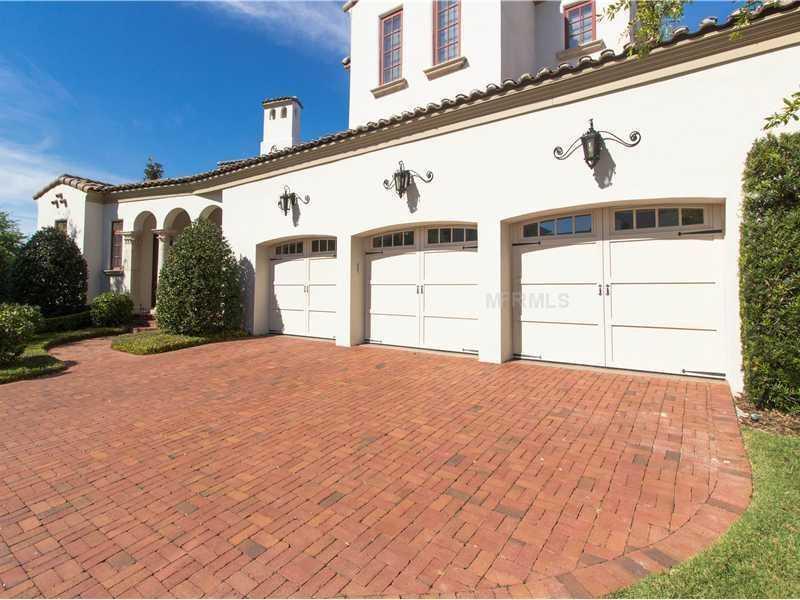 The private driveway has a three-car garage.