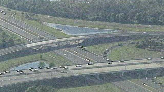 The westbound side of U.S. 192 was closed after construction equipment being hauled by a tractor-trailer struck a bridge at World Drive in Kissimmee.