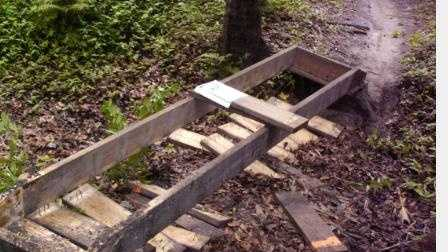 Investigators say someone tore up wooden boards on six trail bridges.