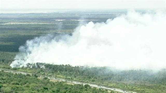 In Volusia County, a brush fired burns near Lake Harney.