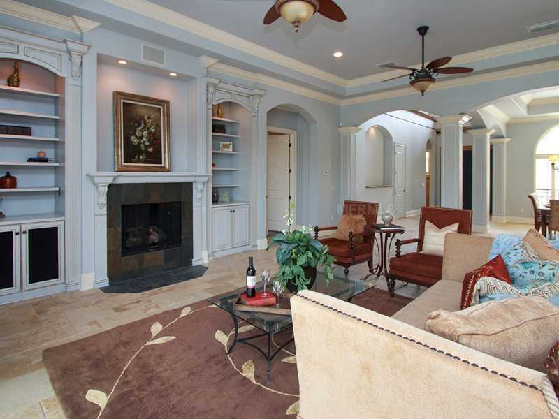 The family room is complete with gas fireplace and custom built-ins.