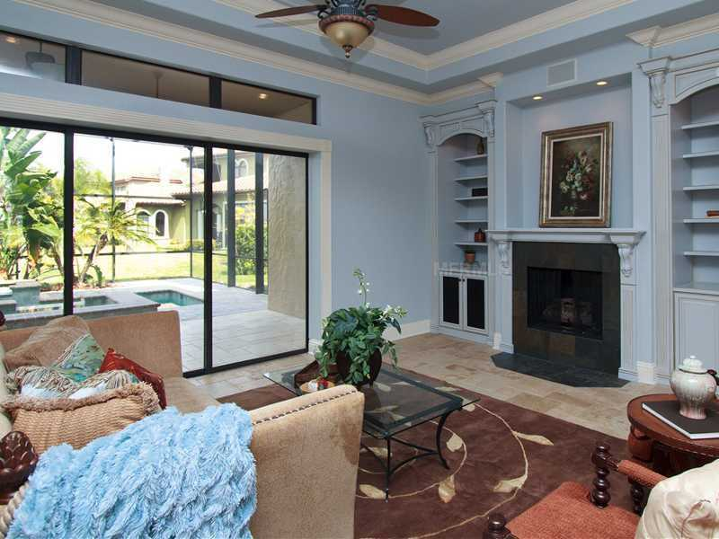 The family room overlooks the luxurious, enclosed pool area.