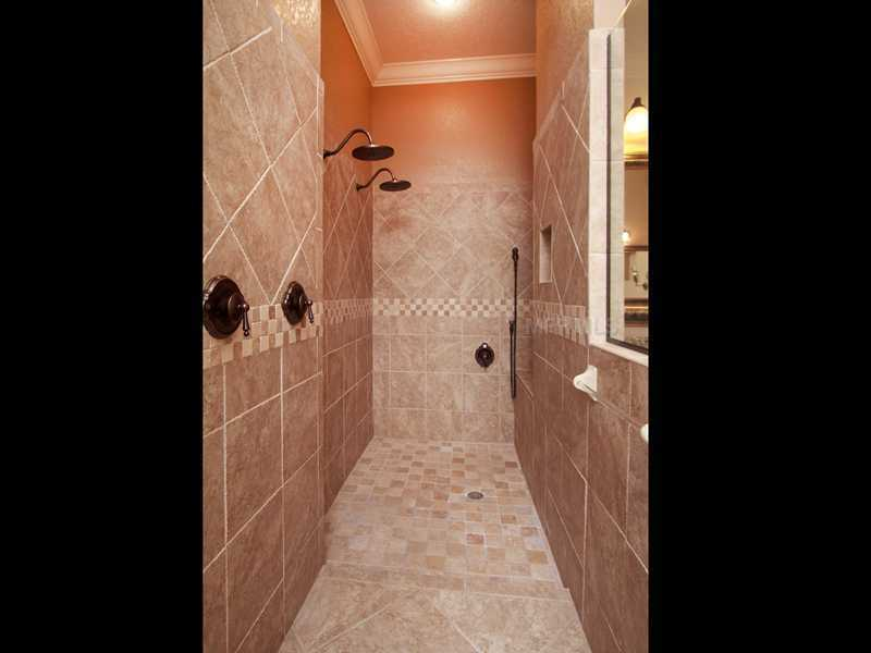 The master bathroom is complete with a separate shower suite.