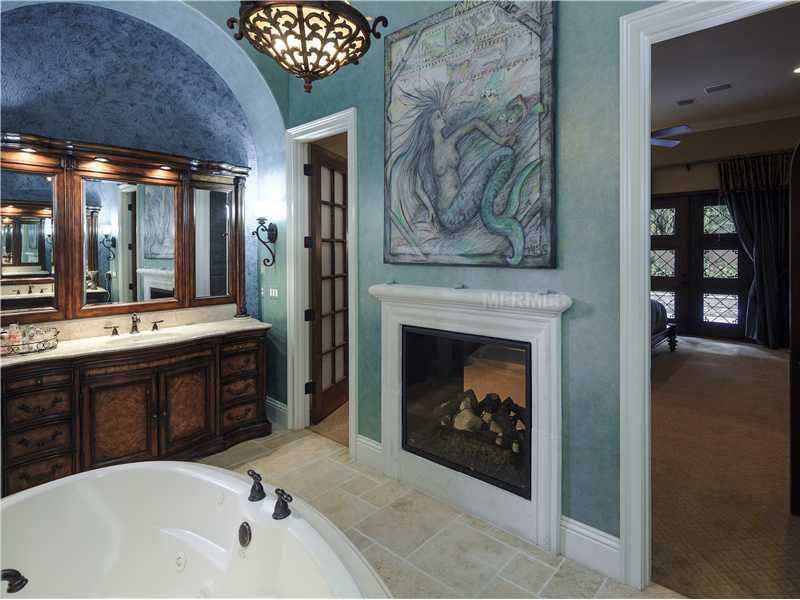 The master bathroom is huge and romantic, featuring over-sized his and hers sinks.