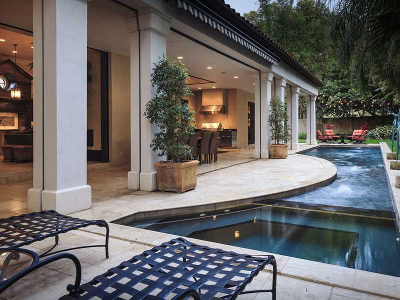 The pool area makes the most out of the space. It even features fountains, which flow over into the pool.