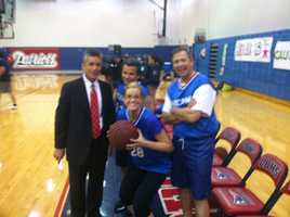 Jim Payne coached the team in a benefit game to raise money for Seminole County's Families in Transition program, which assists the families of homeless students and those in need. (Pictured: Payne, Chief Photographer Pete Delis, McDonough and Fox)