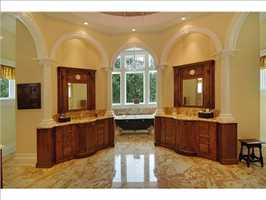 A distant view of the master bathroom.
