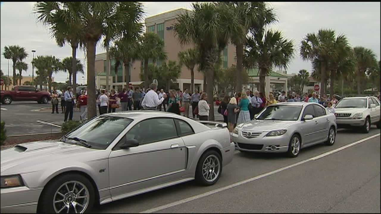 A bomb threat was called in to a Daytona Beach bank Monday morning causing the evacuation of the 10-story Raymond James building.