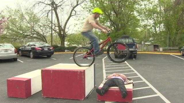 Matt Gilman practices his trick biking moves.