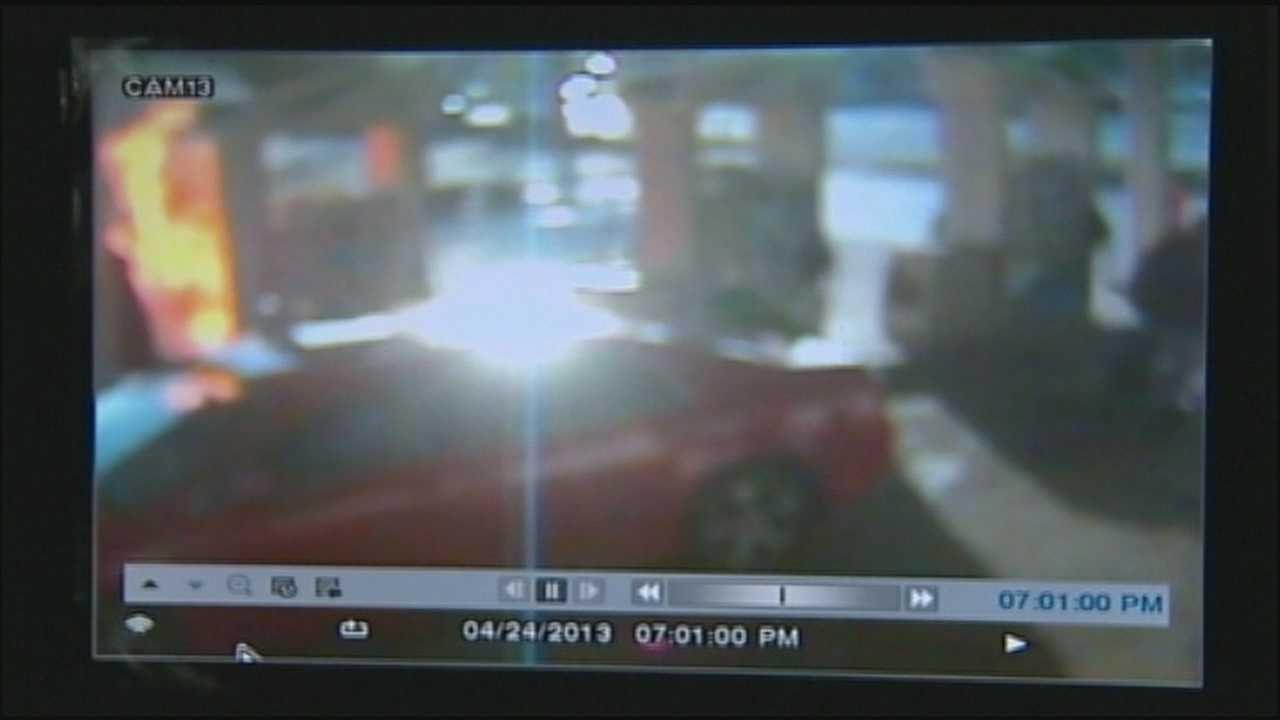 Surveillance shows woman intentionally light car on fire