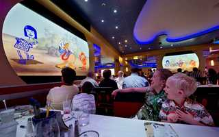 "The enhanced Animator's Palate on the Disney Magic invite guests to experience the tremendously popular ""Animation Magic"" dinner show that celebrates the magic of Disney animation."