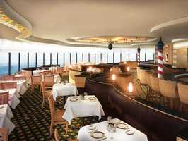 Disney Cruise Line's popular adult-exclusive Palo restaurant receives a makeover on the Disney Magic, with stylish wood fixtures, glass artwork panels, decorative lighting and hand-tufted carpet.