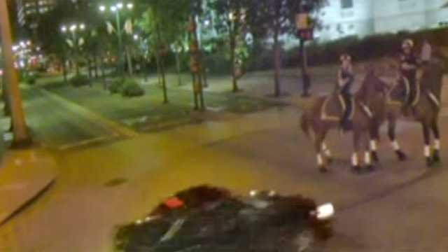 Three Orlando police officers on horseback somehow managed to dodge an alleged drunken driver as he flew threw an intersection downtown. The driver was later arrested and charged with DUI. See the raw video.