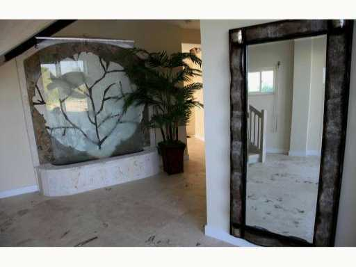 The foyer features a marble, abstract piece.