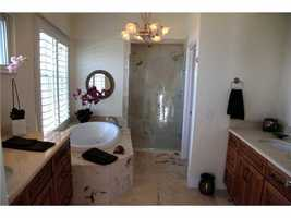 Master bathroom features a relaxing spa tub.