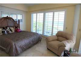 Master bedroom includes a balcony and a potential sitting area.