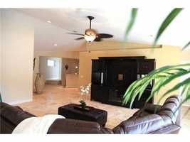 The lowest floor takes you out to the ocean crosswalk and is a perfect space for entertaining. It also includes a wet bar.
