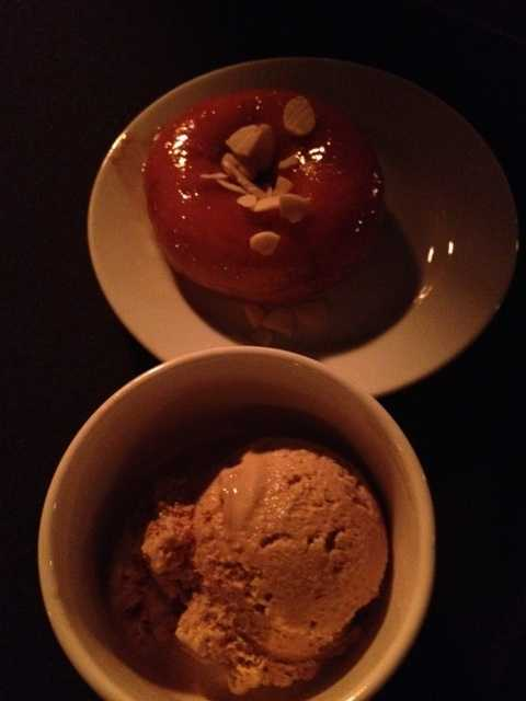 Donuts with almond slivers and coffee ice cream.