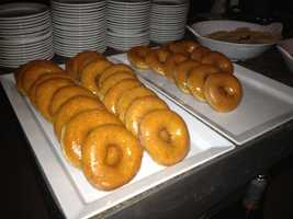 Donuts before they were mixed with sugar, butter and flambéed.